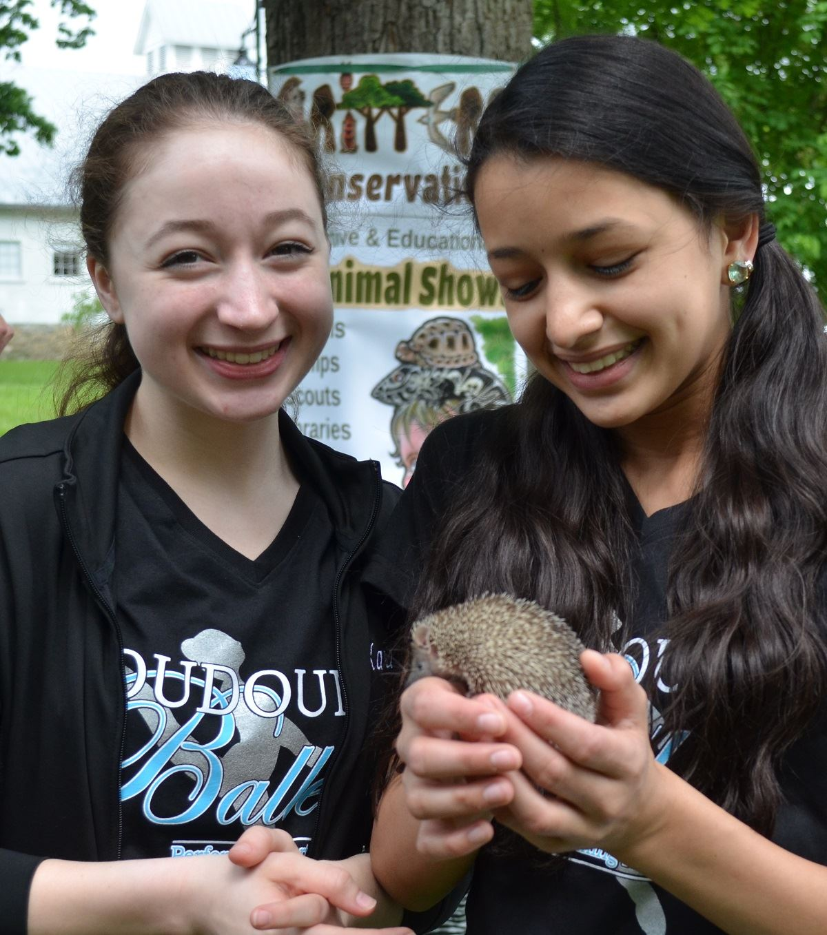 Fun Zone, Critters and Conservation, lesser tenrec and two girls